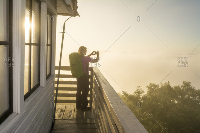A Woman Enjoy Taking Picture During A Foggy Morning At The Green Knob Firetower
