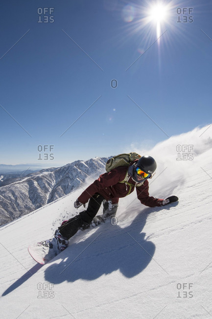 Snowboarding In The Backcountry Taking A Turn In A Fresh Snow Powder