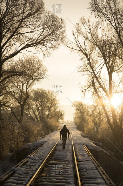 Person Walking On The Railroad Track On The Way To Fly Fishing On The Provo River In Utah, Usa