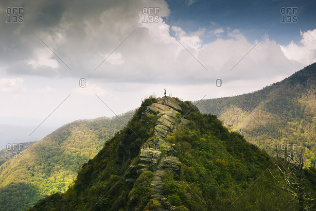 Distant View Of A Man Standing On A Mountain Top In The  Smoky Mountain National Park