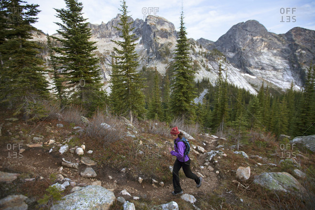A Woman Trail Running In The Drinnon Pass Area Of Valhalla Provincial Park, Canada