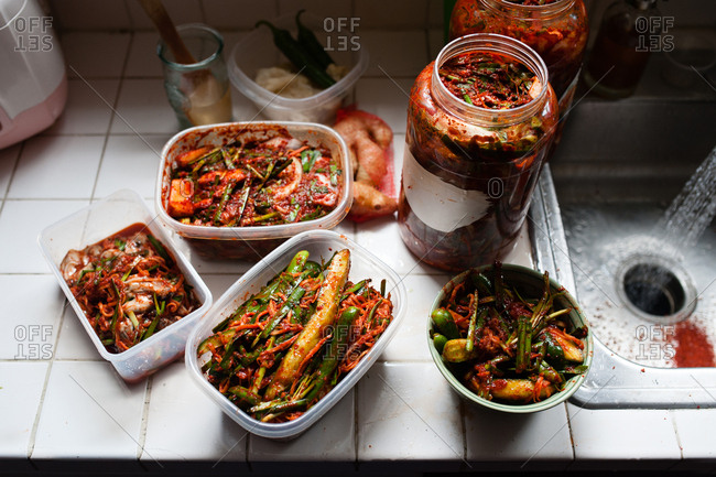 Homemade kimchee in storage containers