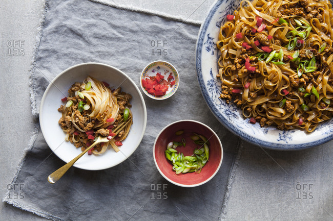 Chinese pork with noodles served on a platter