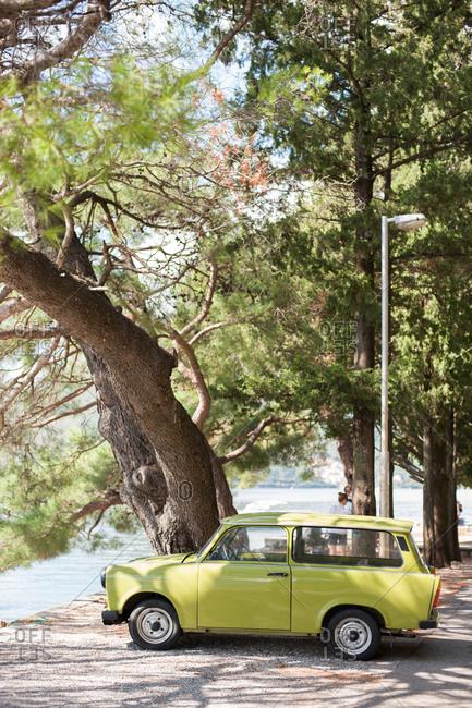 Kotor, Montenegro - July 22, 2015: Vintage car parked on the coast of Kotor, Montenegro