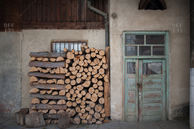 Stack of firewood outside of a house in Sibiu, Romania