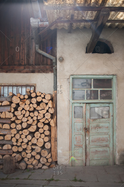 Firewood stacked outside of a house in Sibiu, Romania
