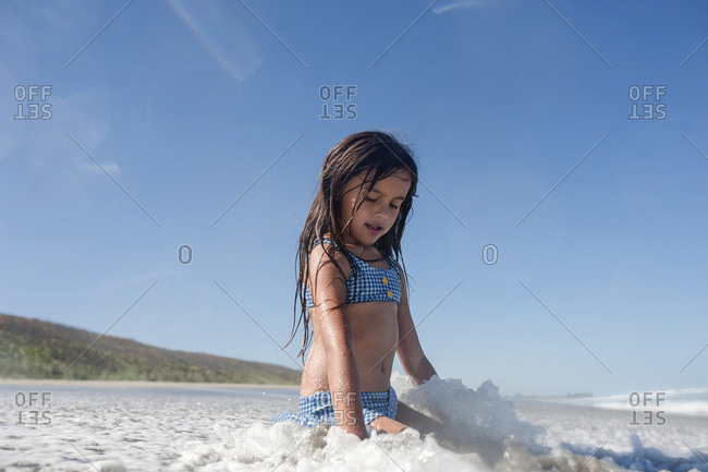 Girl playing in ocean