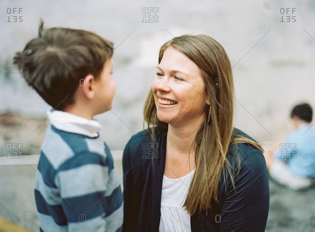 Mom smiling listening to boy