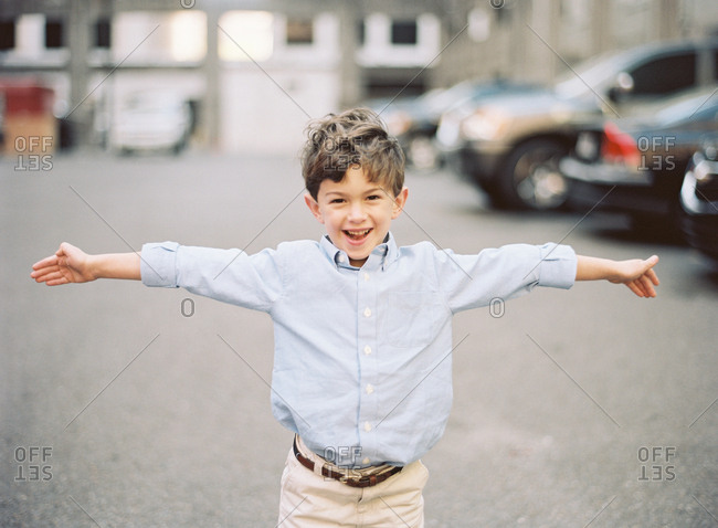 Excited boy in parking lot