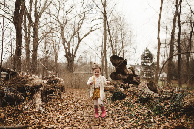 Girl running in wooded setting
