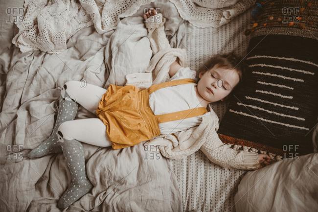Girl sprawled fast asleep on bed