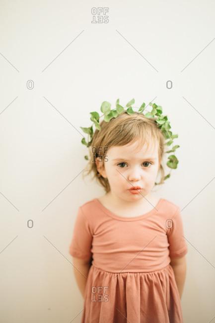 Girl wearing leaf head crown
