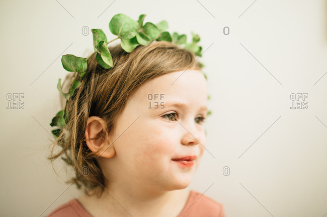 Smiling girl in leaf crown