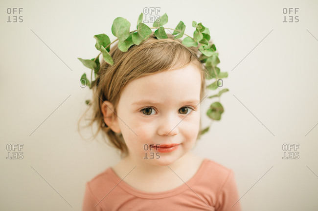 Girl wearing a leafy crown