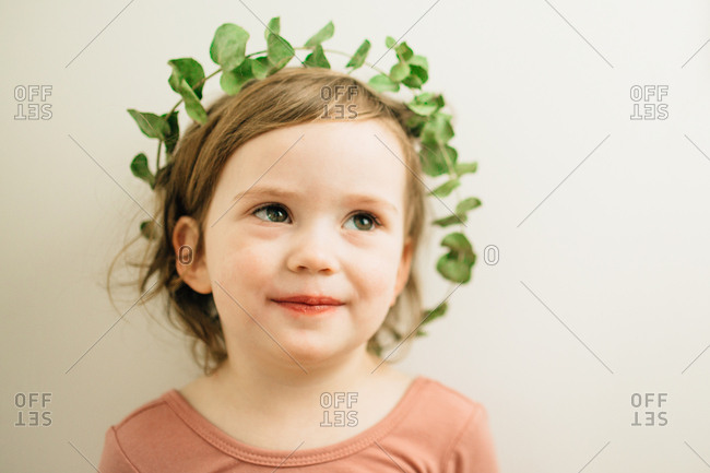 Smiling girl in a leaf crown
