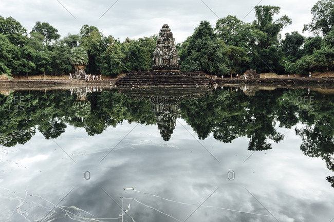 View of Angkor Wat temple reflected in the water in Laos