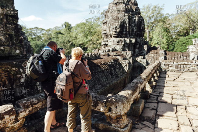 Tourist taking pictures at Angkor Wat temple complex in Laos