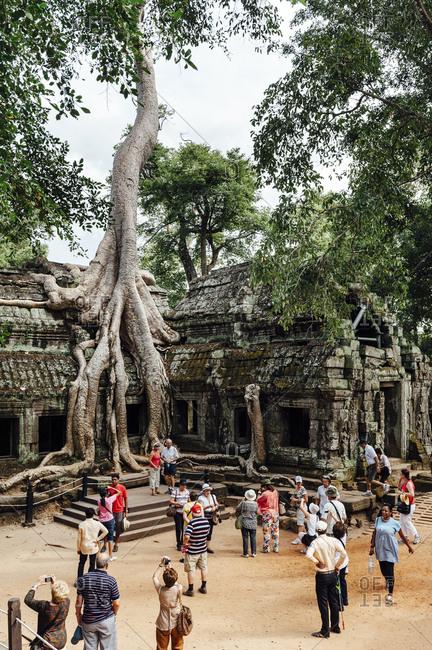 Angkor Wat, Cambodia - December 1, 2010: Tourists visiting Angkor Wat ruins