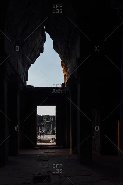 Angkor Wat, Cambodia - December 2, 2010: Tourists visiting Angkor Wat ruins
