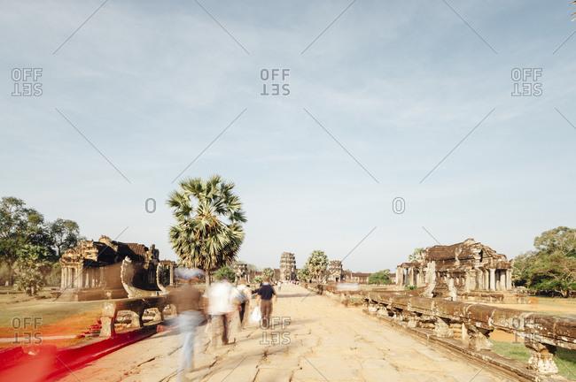 Tourists visiting Angkor Wat ruins, Cambodia