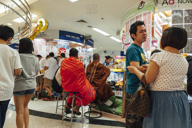 Bangkok, Thailand - November 15, 2010: Buddhist monks waiting to be seen at a mall in Siam Center