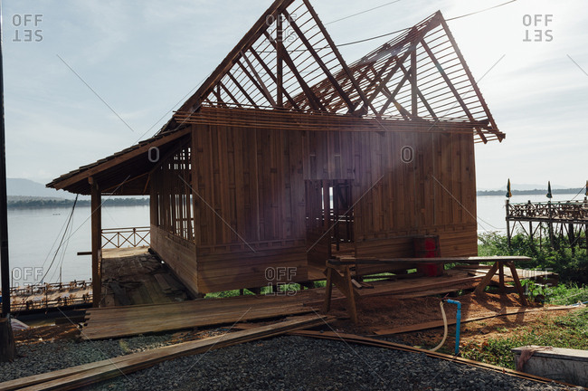 Rustic wooden house under construction in Pakse, Laos