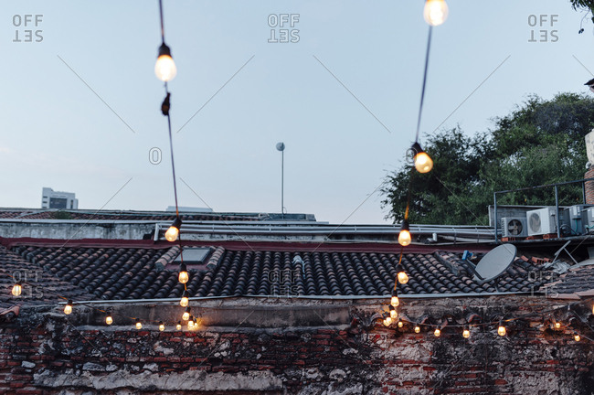 Garlands of light bulbs on a roof in Cartagena de Indias, Colombia