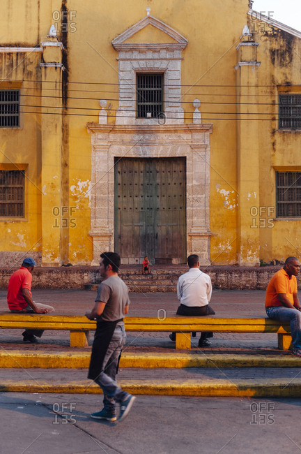 Cartagena de Indias, Colombia - March 4, 2017: Local citizens having a break in Plaza de la Trinidad at Getsemani neighborhood