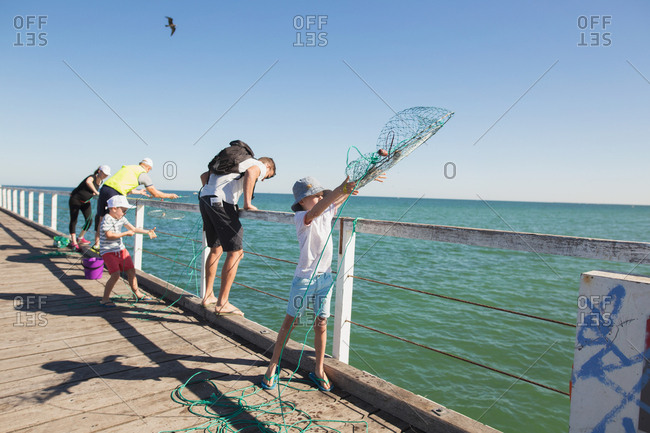 Kids throwing nets off dock
