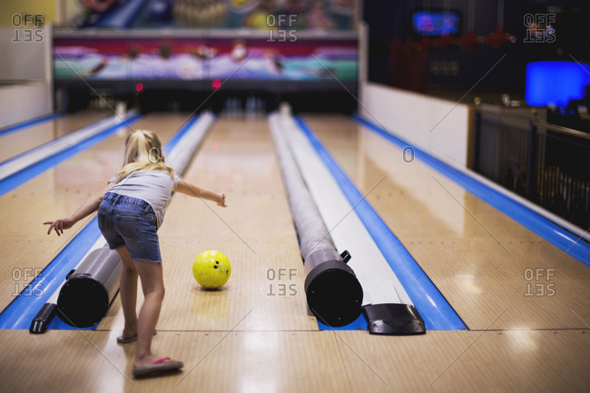 Girl rolling a bowling ball