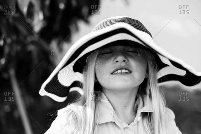 Girl wearing striped hat outside