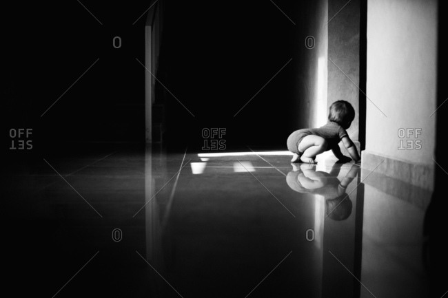 Toddler crawling on a tiled floor