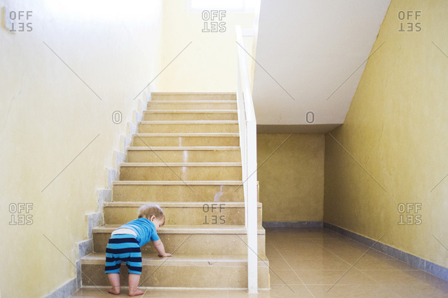 Toddler climbing up steps