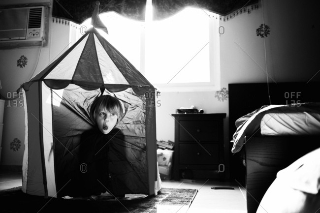 Boy being goofy in play tent