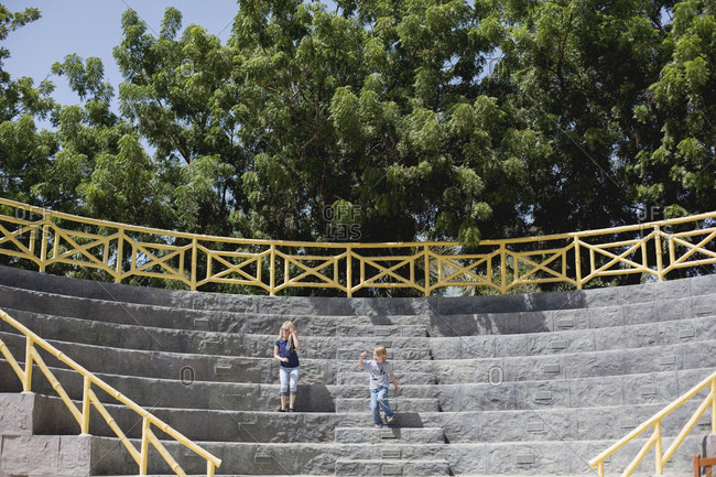 Kids exploring park amphitheater steps