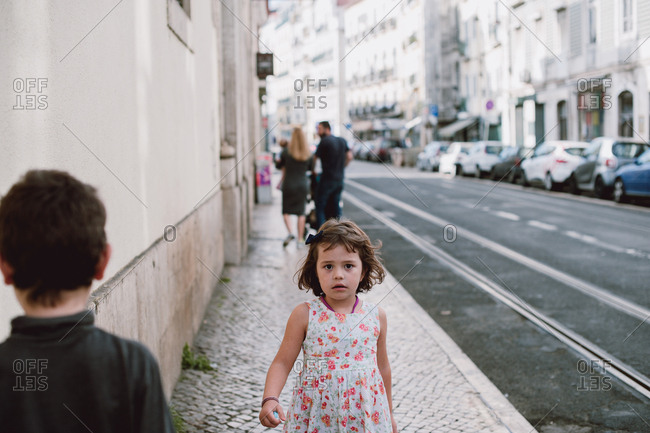 Young girl walking alone in the city