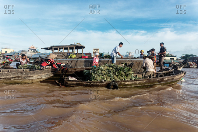 Mekong Delta, Vietnam - January 1, 1904: Floating market in Mekong River