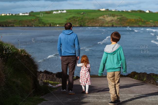 Family walking at the seashore in Ireland