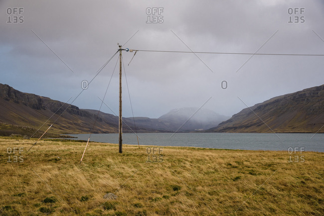 Electricity line beside a lake and mountains in Iceland