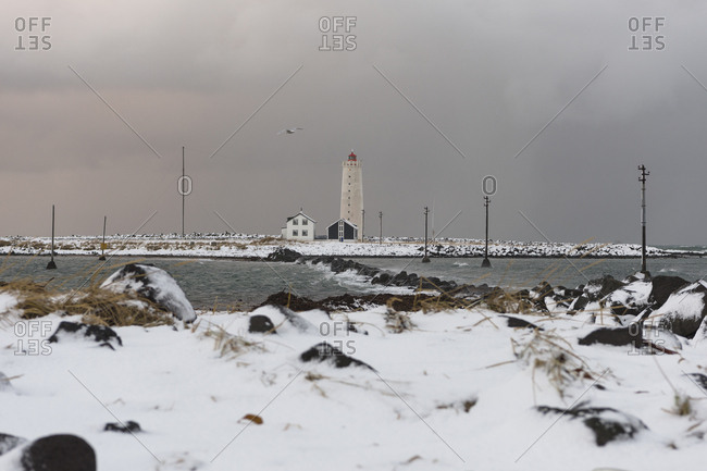 Grotta Island Lighthouse and snowy landscape in Reykjavik, Iceland