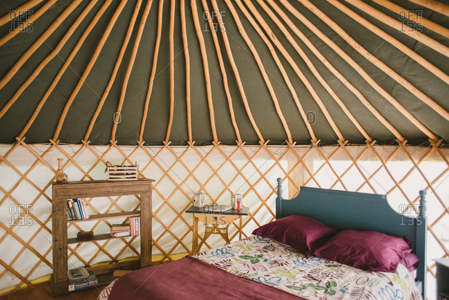 February 4, 2017 - Dordogne, France: Ceiling poles and lattice side details of a yurt camping shelter