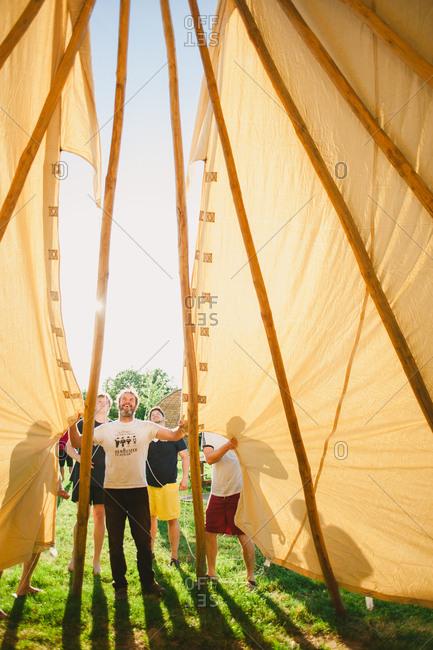 February 4, 2017 - Dordogne, France: Men setting up a tent