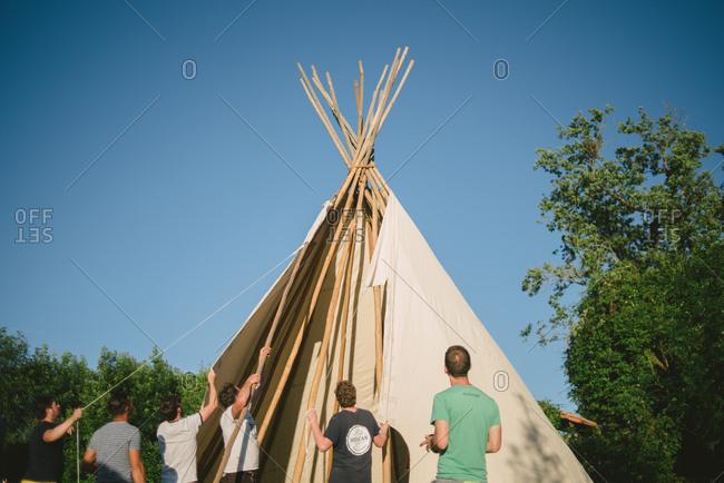 February 4, 2017 - Dordogne, France: Men setting up a teepee