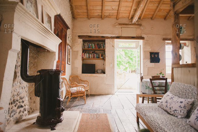 February 4, 2017 - Dordogne, France: Cottage living room with wood stove