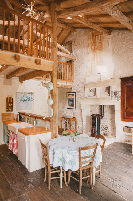 February 4, 2017 - Dordogne, France: Small kitchen, living room and loft bedroom in a cozy cottage