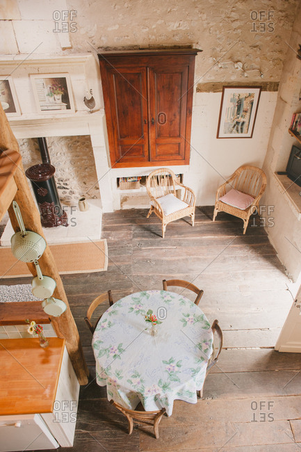 February 4, 2017 - Dordogne, France: Elevated view of dining and sitting area in cozy rustic cottage