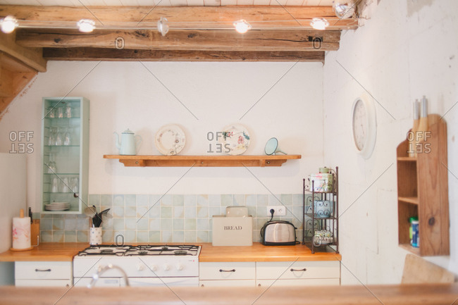 February 4, 2017 - Dordogne, France: Quaint blue tiled kitchen in a rustic cottage