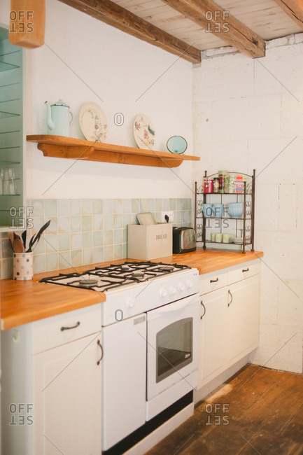 February 4, 2017 - Dordogne, France: Stove and countertop in a cottage kitchen