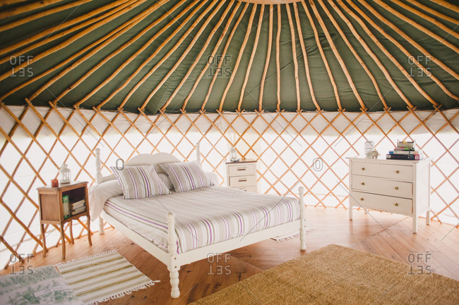 February 4, 2017 - Dordogne, France: Tidy white wooden bed in yurt with wood floor