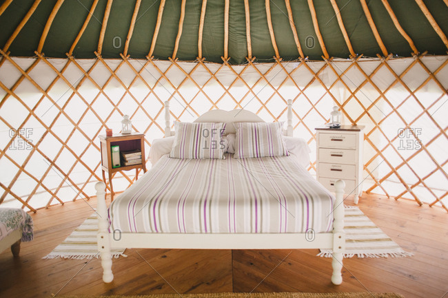 February 4, 2017 - Dordogne, France: Simple, elegant furnishings in yurt with wood floor